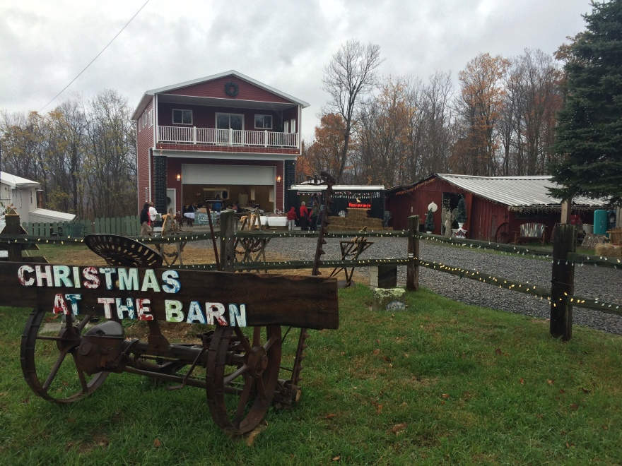 Photo taken at the event, Christmas at the Barn, which shows two barns surrounded by lights.