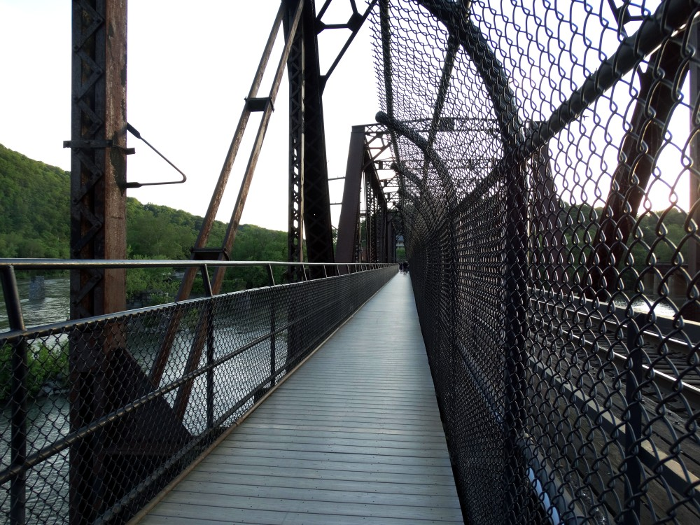 Image of a bridge next to a chain fence.
