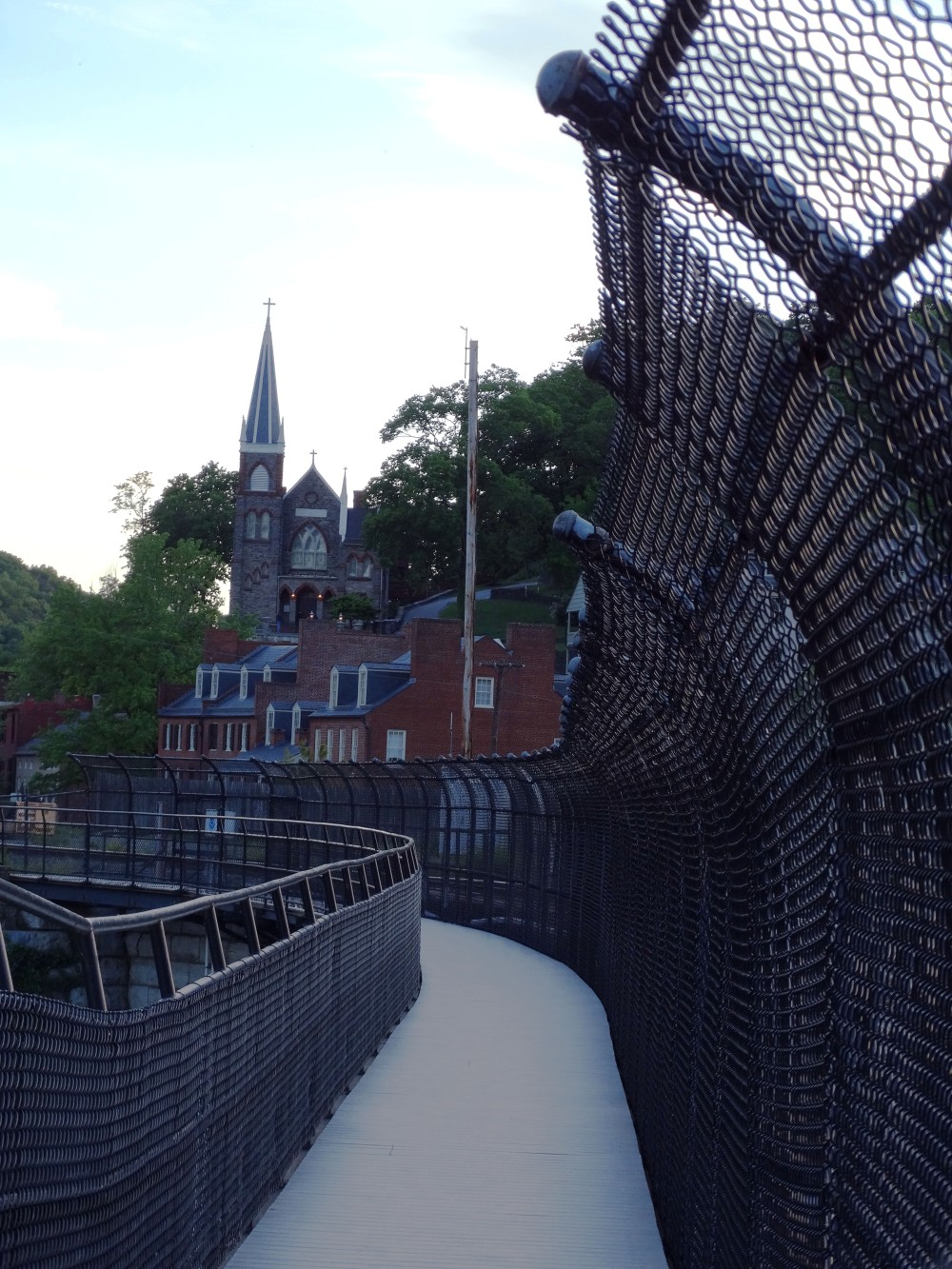 Image of a chain fence with Harpers Ferry in the background.